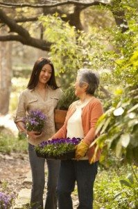 two women with flowers in garden
